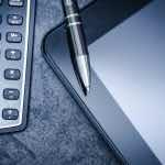 calculator, pen and ipad